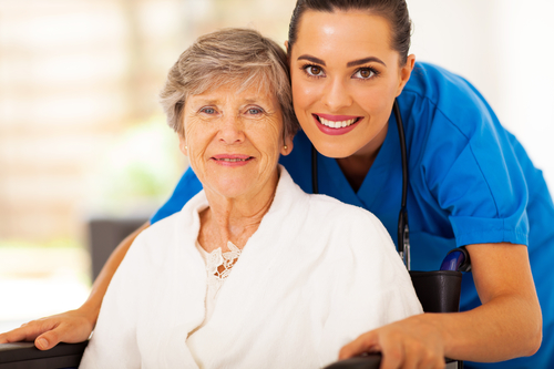 Senior Woman in Wheelchair with her In-Home Caregiver