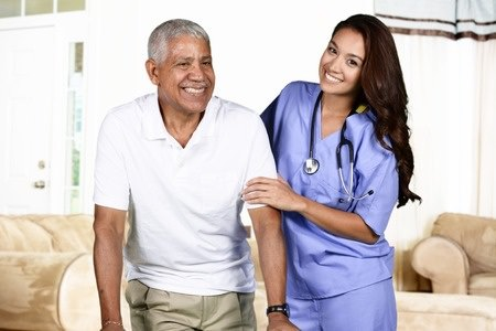 Nurse helping an elderly man