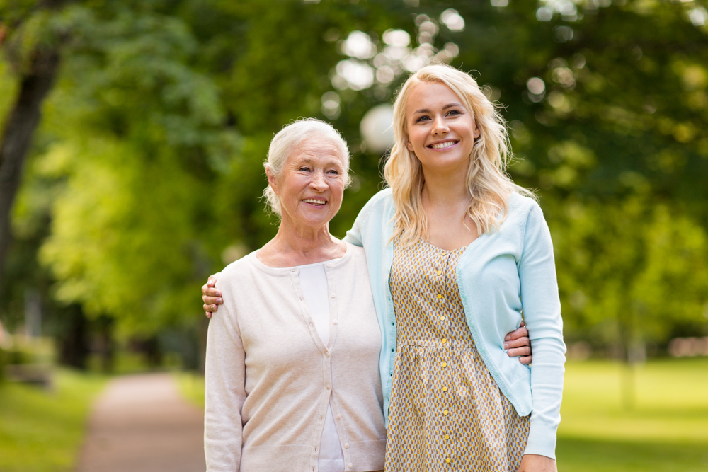 An older woman and her daughter/caregiver
