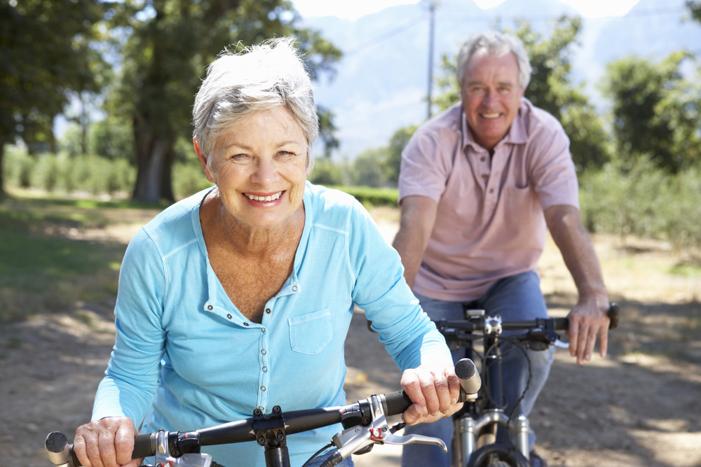 A senior couple riding their bikes - great exercise!