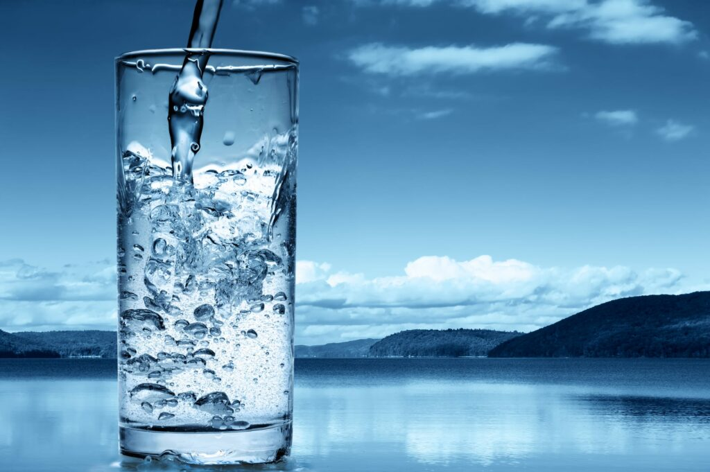 Water pouring into a glass - showing the importance of hydration